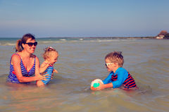 Mother with kids playing ball at the beach Royalty Free Stock Photo