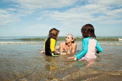 Family playing at beach. Family beach vacation Stock Photography