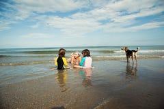 Family playing at beach. Family beach vacation stock photos