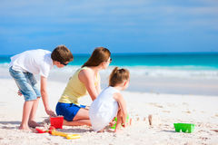Mother and kids playing at beach Stock Photography