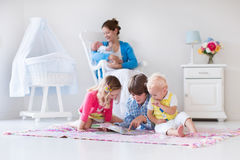 Mother and kids playing in bedroom royalty free stock photography