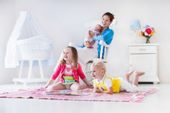 Mother and kids playing in bedroom Royalty Free Stock Photos