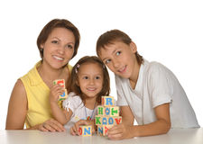 Mother and  kids playing with cubes Stock Photo