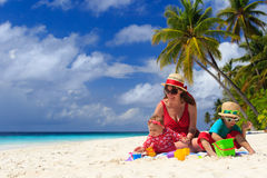 Mother and kids playing on tropical beach Royalty Free Stock Photos
