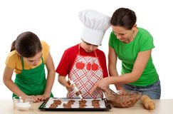 Mother with  kids preparing cakes Royalty Free Stock Image