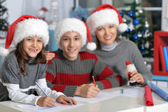 Mother with kids preparing for Christmas Royalty Free Stock Photos