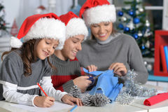 Mother with kids preparing for Christmas Royalty Free Stock Photography