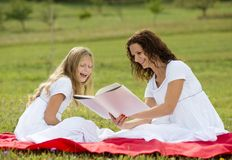 Mother and kids reading a book Stock Photo