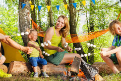 Mother and kids roasting marshmallow over the fire Stock Image