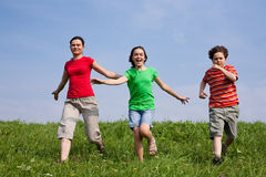 Mother with kids running Stock Photos