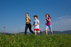 Mother with kids running Royalty Free Stock Image