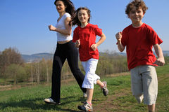 Mother with kids running. Active family - mother with kids running