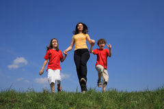 Mother with kids running Stock Photo