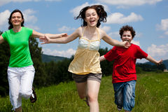Mother with kids running outdoor Stock Images