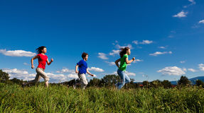 Mother with kids running outdoor Stock Photos