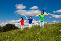 Mother with kids running outdoor Stock Photography