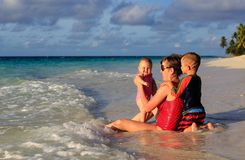 Mother and kids on sea vacation royalty free stock photos
