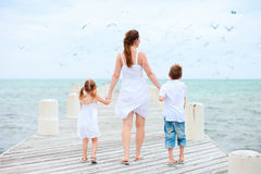 Mother and kids at seaside Stock Photos