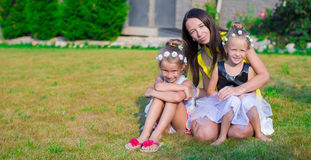 Mother and kids sitting outdoors at beautiful Royalty Free Stock Photo