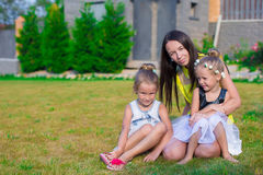 Mother and kids sitting outdoors at beautiful Royalty Free Stock Photography