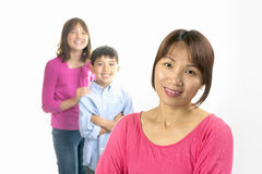 Mother and kids smiling. Stock Photos