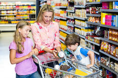 Mother and kids at the supermarket Royalty Free Stock Photography