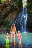 Mother with kids swim in water pool under waterfall Stock Photo