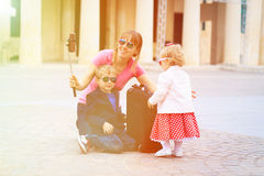Mother and kids taking selfie stick picture while Stock Image