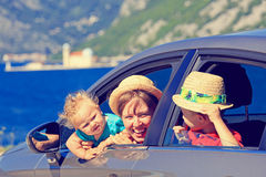 Mother with kids travel by car at the sea Stock Photo