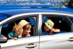 Mother with kids travel by car on sea vacation Stock Photos