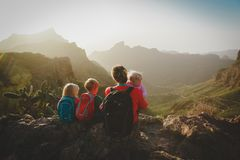 Family with kids travel hiking in mountains looking at view. Mother with kids travel hiking in mountains looking at view royalty free stock images