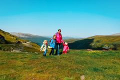 Mother with kids travel hiking in nature. S, mountains, Norway travel royalty free stock photo