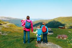 Mother with kids travel hiking in nature. S, mountains, Norway travel stock photos