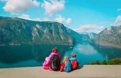 Mother with kids travel looking at scenic nature, family vacation. Norway travel royalty free stock photo