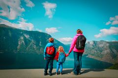 Mother with kids travel in nature, looking at view, Norway. Europe royalty free stock photography