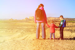 Mother with kids travel in scenic mountains Stock Images