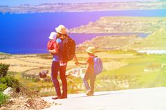 Mother with kids travel on scenic road Stock Photos