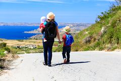 Mother with kids travel on scenic road Royalty Free Stock Images