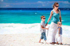 Mother with kids on tropical beach Royalty Free Stock Photo