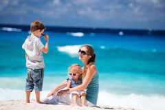 Mother with kids on tropical beach Stock Image