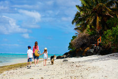 Mother and kids on a tropical beach Royalty Free Stock Photo