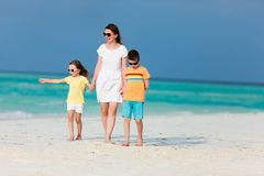 Mother and kids on a tropical beach Stock Photo