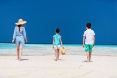 Mother and kids at tropical beach Stock Photos
