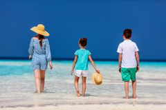 Mother and kids at tropical beach Stock Image
