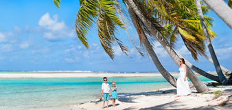 Mother and kids on tropical island Stock Image