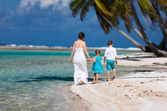 Mother and kids on a tropical island Stock Images