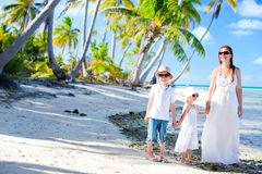 Mother and kids on a tropical vacation Royalty Free Stock Image