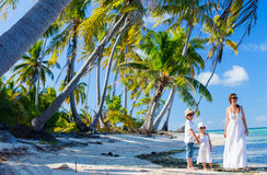 Mother and kids on a tropical vacation Stock Images