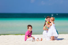 Mother and kids on vacation. Mother and kids at tropical beach during summer vacation stock photos