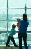 Mother with kids waiting in the airport Stock Photography
